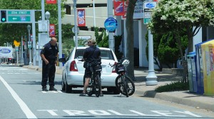 Cops pull over car in a bicycle